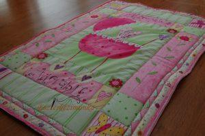 Rózsaszín foltos babatakaró
